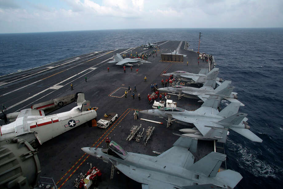F/A-18 Super Hornets are seen on the deck of the nuclear-powered USS George Washington (CVN73) off southern coast of Vietnam in South China Sea Saturday, Oct. 20, 2012. A U.S. aircraft carrier group cruised through the disputed South China Sea on Saturday in a show of American power in waters that are fast becoming a focal point of Washington's strategic rivalry with Beijing. (AP Photo/Na Son Nguyen) / AP