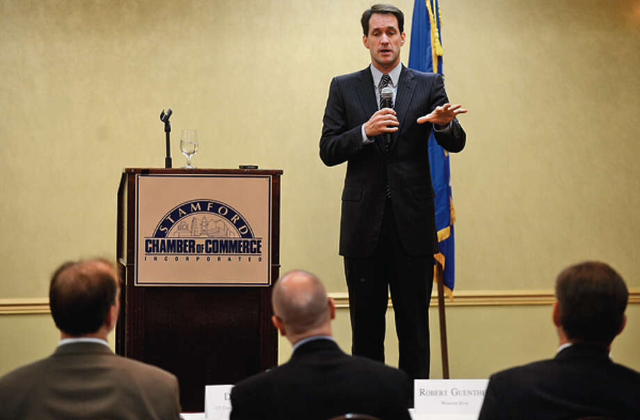 Congressman Jim Himes (D-4) answers questions during a forum sponsored by the Stamford Chamber of Commerce at the Stamford Forum Wednesday. Hour photo / Erik Trautmann / (C)2012, The Hour Newspapers, all rights reserved