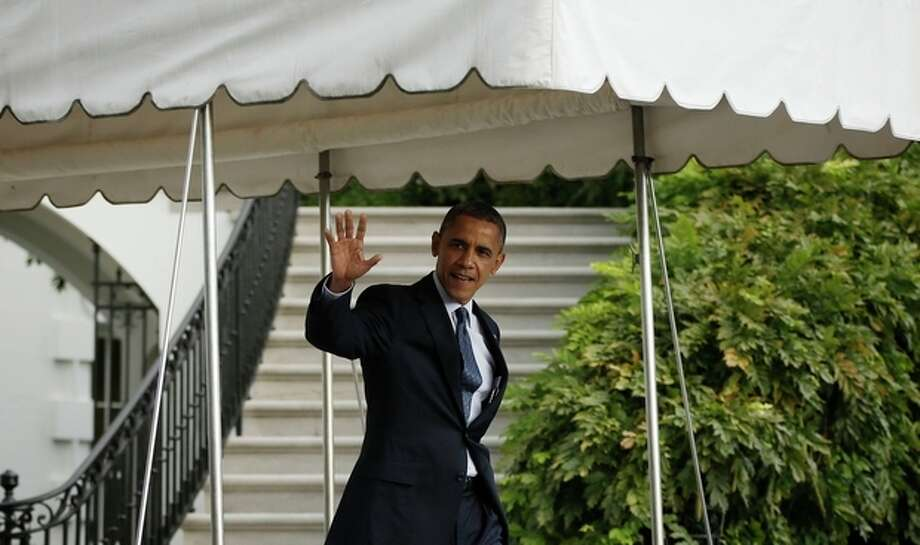 President Barack Obama waves as he walks out of the White House in Washington, Friday, Oct., 19, 2012, before his departure on Marine One helicopter for a trip to the presidential retreat at Camp David, Md., to spend the weekend preparing for his final presidential debate.(AP Photo/Pablo Martinez Monsivais) / AP