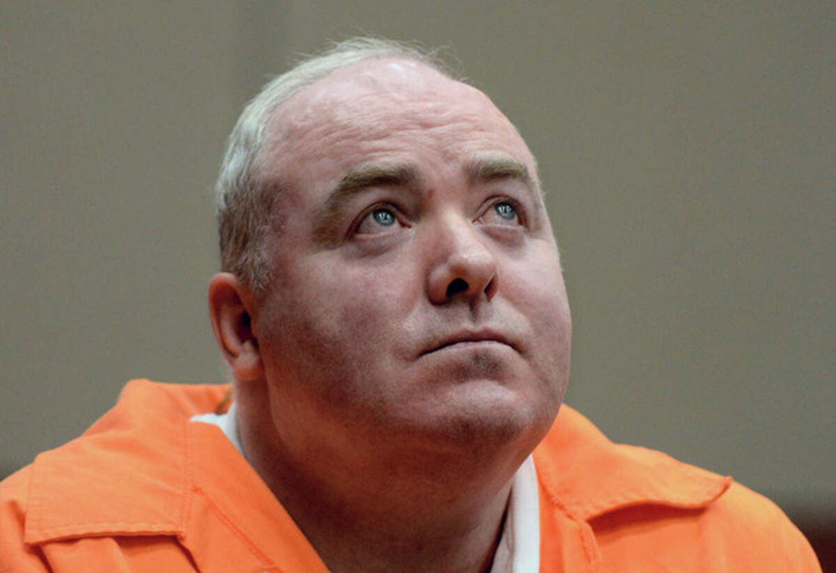 FILE - In this Jan. 24, 2012 file photo, Michael Skakel looks up while listening to a statement from John Moxley, brother of victim Martha Moxley in court in Middletown, Conn. Skakel's first parole hearing is scheduled for Wednesday, Oct. 24, 2012, at McDougall-Walker Correctional Institution in Suffield. Officials say Skakel is eligible to be released next spring if parole officials approve it. He is serving 20 years to life for fatally beating Martha Moxley with a golf club in Greenwich when they were 15-year-old neighbors. (AP Photo/Jessica Hill, Pool, File)