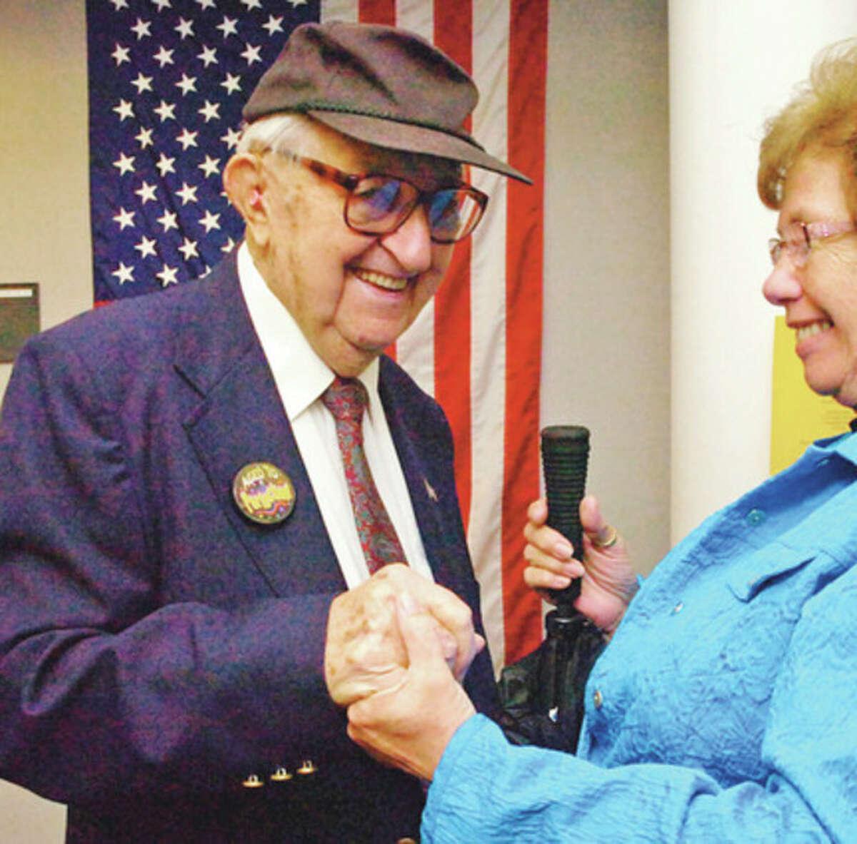 Hour file photo / Erik Trautmann Bill Harrick, the oldest city poll worker, celebrated his then 100th birthday with Norwalk Republican Registrar of Voters, Karen Doyle Lyons.