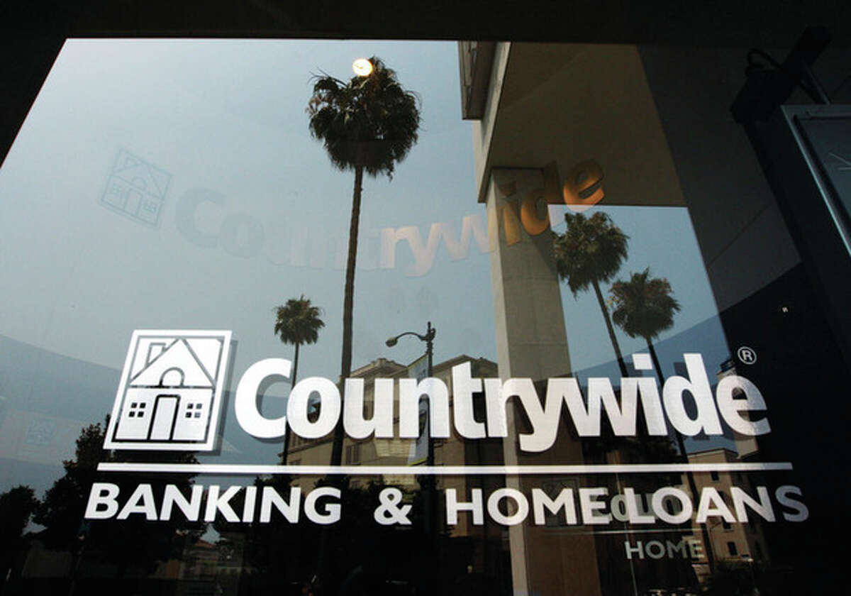 AP file photo / Kevork Djansezian In this June 25, 2008, file photo, buildings and palm trees are reflected on the entrance of the Countrywide Financial Corp. office in Beverly Hills, Calif.