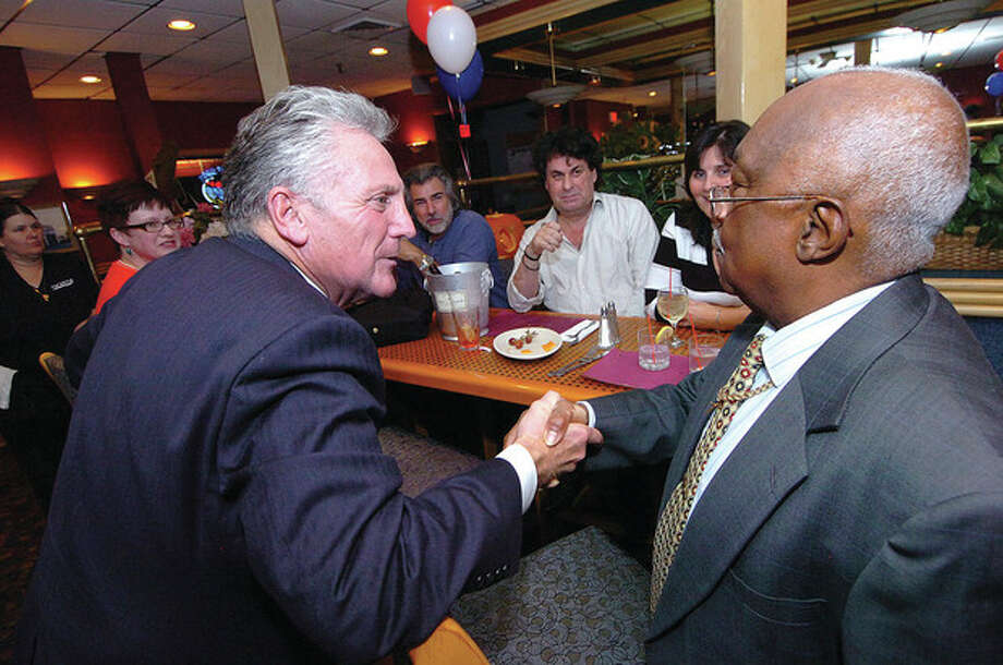 Hour photo / Alex von KleydorffFormer Norwalk Police Chief Harry Rilling, left, talks with Bobby Burgess, chairman of the Ward B Democrats, at the East Side Cafe Wednesday night in East Norwalk. / 2012 The Hour Newspapers