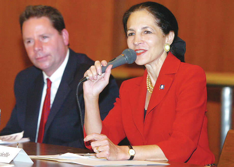 Hour photo / Alex von KleydorffGail Lavielle answers a question during a debate with Ted Hoffstatter in their race for the 143rd District Wednesday night at St. Peter's Lutheran Church in Norwalk. / 2012 The Hour Newspapers