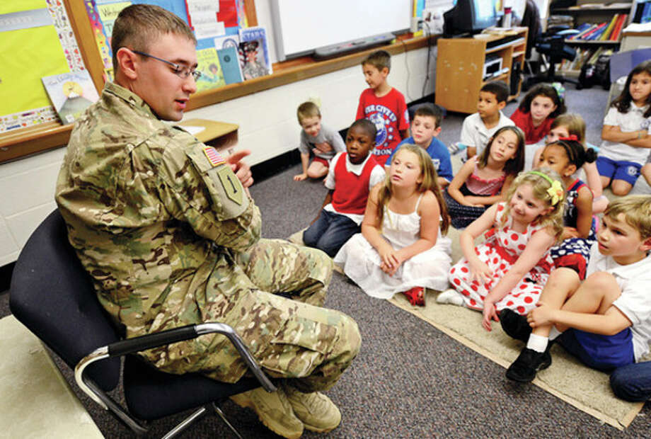 US National Guard soldier and Norwalk native, Master Seargant Scott Spezzano, visits Mrs. Smith's first grade class at All Saints School Tuesday after the class adopted him during his tour in Afghanistan.Hour photo / Erik Trautmann / (C)2013, The Hour Newspapers, all rights reserved