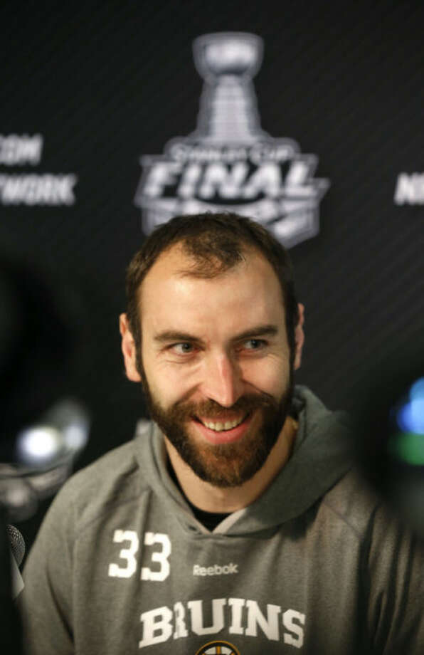 Boston Bruins defenseman Zdeno Chara smiles during a news conference for the Stanley Cup Final hockey series between the Chicago Blackhawks and the Bruins Tuesday, June 11, 2013 in Chicago. The first game of the Stanley Cup final series is Wednesday in Chicago.(AP Photo/Charles Rex Arbogast)