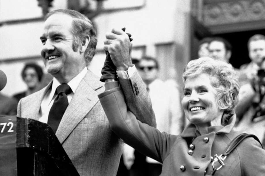 FILE - In this Oct. 31, 1972 file photo, Sen. George McGovern holds up the hand of his wife Eleanor and announced to the crowd gathered in downtown Syracuse that today is their 29th wedding anniversary. A family spokesman says, McGovern, the Democrat who lost to President Richard Nixon in 1972 in a historic landslide, has died at the age of 90. According to the spokesman, McGovern died Sunday, Oct. 21, 2012 at a hospice in Sioux Falls, surrounded by family and friends. (AP Photo/Bob Schutz) / AP