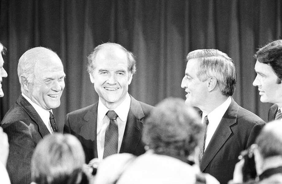 FILE - In this Oct. 13, 1983 file photo, Presidential hopefuls, Sen. John Glenn, left, former Sen. George McGovern, center, and former Vice-President Walter Mondale, right, pause for photographers after debating the nuclear arms issue at the Kennedy School of Government at Harvard University in Cambridge, Mass. A family spokesman says, McGovern, the Democrat who lost to President Richard Nixon in 1972 in a historic landslide, has died at the age of 90. According to the spokesman, McGovern died Sunday, Oct. 21, 2012 at a hospice in Sioux Falls, surrounded by family and friends. (AP Photo/Elise Amendola, File) / AP