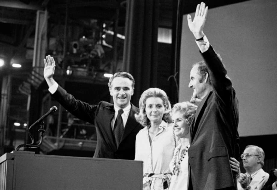 FILE - In this July 14, 1972 file photo, Sen. George S. McGovern with his wife, Eleanor, and Sen. Thomas F. Eagleton with his wife, Barbara Ann, stand before the Democratic National Convention delegates who chose them to try to capture the White House from President Richard Nixon in Miami. A family spokesman says, McGovern, the Democrat who lost to President Richard Nixon in 1972 in a historic landslide, has died at the age of 90. According to the spokesman, McGovern died Sunday, Oct. 21, 2012 at a hospice in Sioux Falls, surrounded by family and friends. (AP Photo) / AP