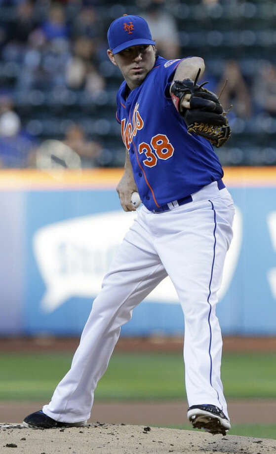 New York Mets' Shaun Marcum (38) delivers a pitch during the first inning of a baseball game against the Chicago Cubs, Friday, June 14, 2013, in New York. (AP Photo/Frank Franklin II)