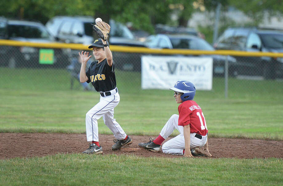 Hour photo/Alex von KleydorffAugust Theoharides of the Pirates, left, tries to hold on to the ball as Joey Bohacs of the Reds slides safely into second base during Friday night's Wilton Little League championship game. The Reds won, 10-9, in seven innings.