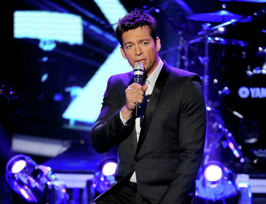 """FILE - This May 2, 2013 file photo released by Fox shows singer Harry Connick Jr. performing onstage at FOX's American Idol Season 12 Top 4 To 3 Live Elimination Show in Los Angeles. Connick Jr. has written a song in honor of a 6-year-old girl killed in the Newtown school shooting. Connick this week released the song """"Love Wins"""" dedicated to Ana Grace Marquez-Greene. He says proceeds will go to the Ana Grace Fund set up to help the girl's family. Connick played with the girl's jazz saxophonist father, Jimmy Greene, and sang at the funeral for Ana, one of 20 first-graders and six adults killed in December at Sandy Hook Elementary School. (AP Photo/Fox, Frank Micelotta) / Fox"""