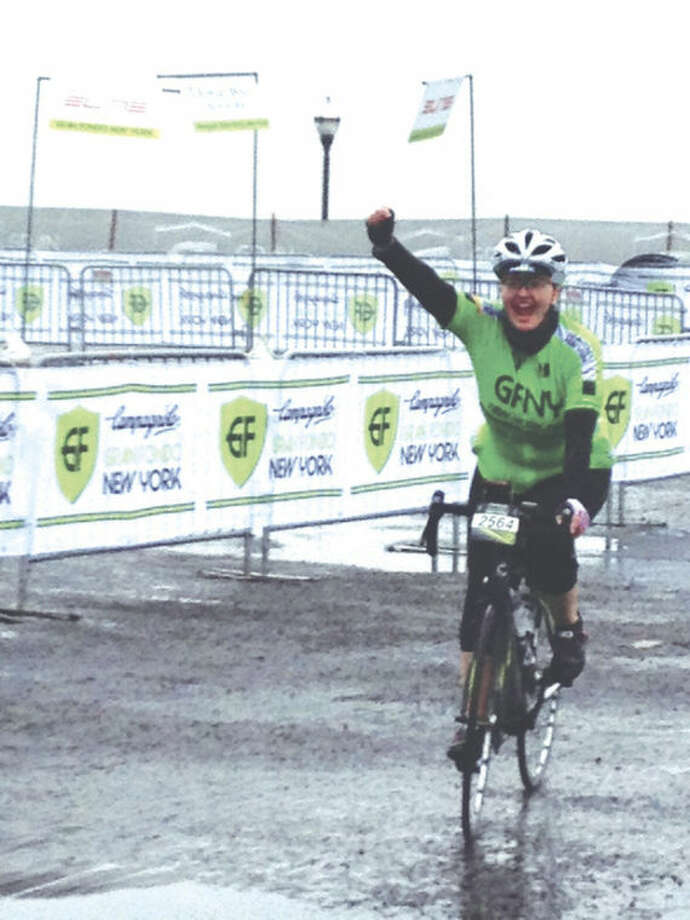 Contributed photoDerry Blatt raises her fist in victory upon completing a 105-mile Campagnolo Gran Fondo New York bicycle race despite having to undergo cancer therapy.