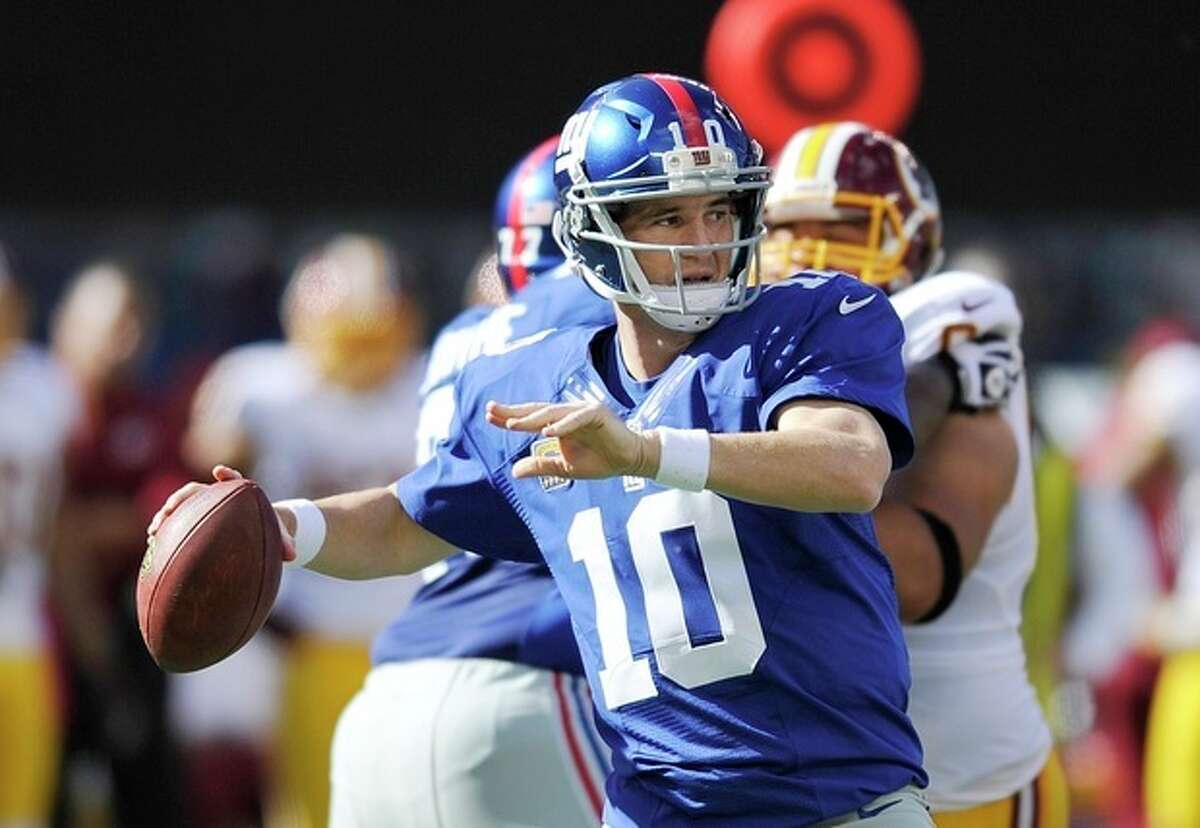 New York Giants quarterback Eli Manning (10) looks to pass during the first half of an NFL football game against the Washington Redskins Sunday, Oct. 21, 2012 in East Rutherford, N.J. (AP Photo/Bill Kostroun)