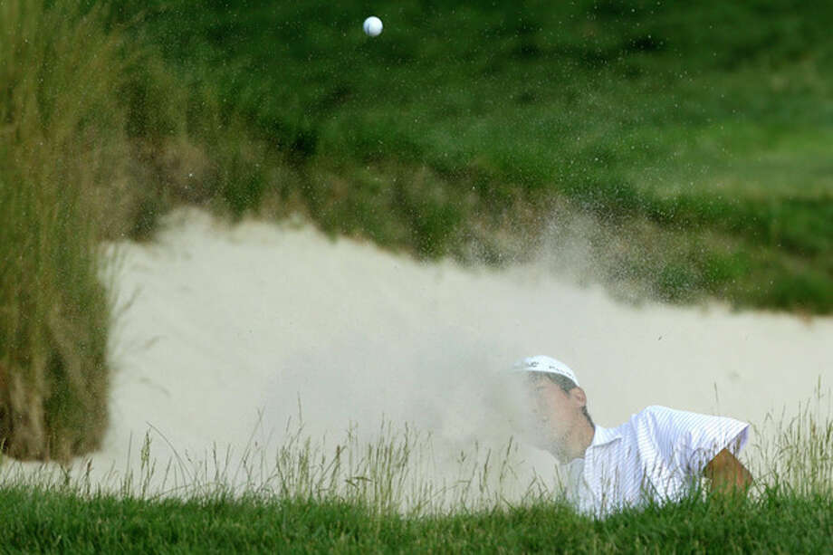Michael Kim hits out of a bunker on the 17th hole during the third round of the U.S. Open golf tournament at Merion Golf Club, Saturday, June 15, 2013, in Ardmore, Pa. (AP Photo/Julio Cortez) / AP