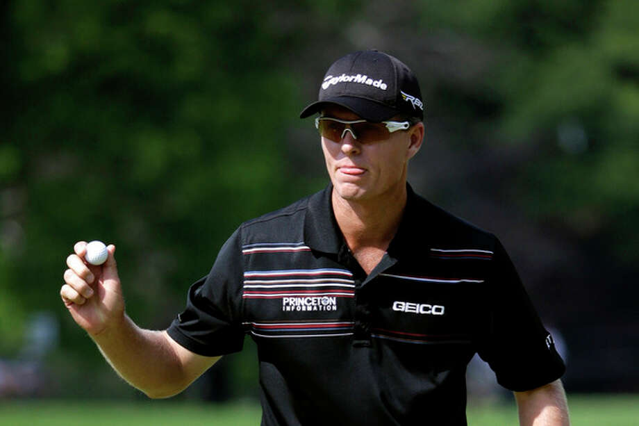 John Senden, of Australia, reacts after a putt on the fifth hole during the third round of the U.S. Open golf tournament at Merion Golf Club, Saturday, June 15, 2013, in Ardmore, Pa. (AP Photo/Gene J. Puskar) / AP