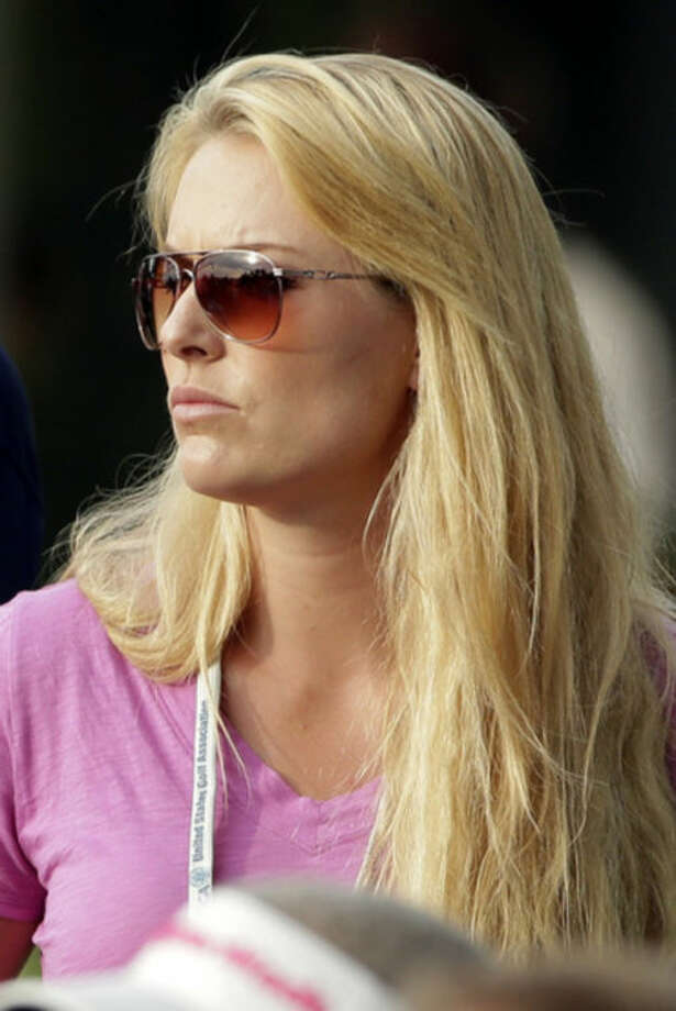 Lindsey Vonn watches from the gallery on the 18th green during the third round of the U.S. Open golf tournament at Merion Golf Club, Saturday, June 15, 2013, in Ardmore, Pa. (AP Photo/Charlie Riedel)