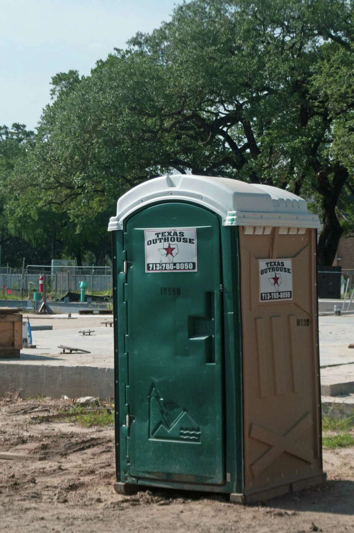 A Texas Outhouse portable toilet sports its trademarked logo of the outline of Texas and a lone star.