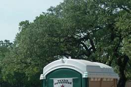 A portable toilet supplied by Texas Outhouse is available for the construction workers building the new Evelyné•s Park in Bellaire. Texas Outhouse has sued one of competitors, Texas Waste Co., in a trademark dispute over the use of the Texas map and star.  Rick Campbell