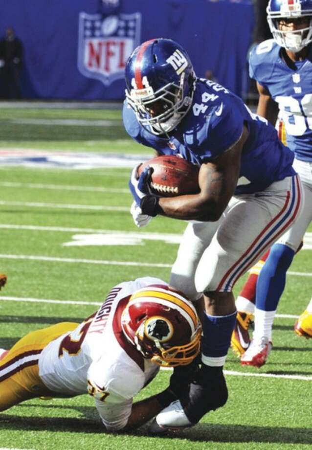 AP photoNew York Giants running back Ahmad Bradshaw (44) is tackled by Washington Redskins safety Reed Doughty during Sunday's game. The emotional Bradshaw yelled at Giants coach Tom Coughlin during the game, but the two talked things over Monday.