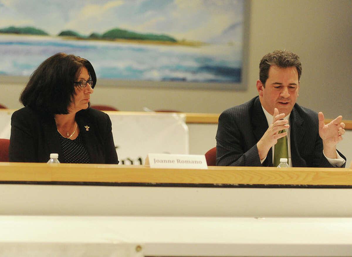 Hour photo / Matthew Vinci Republican challenger Joanne T. Romano debates Democrat Christopher R. Perone Monday at Norwalk City Hall.