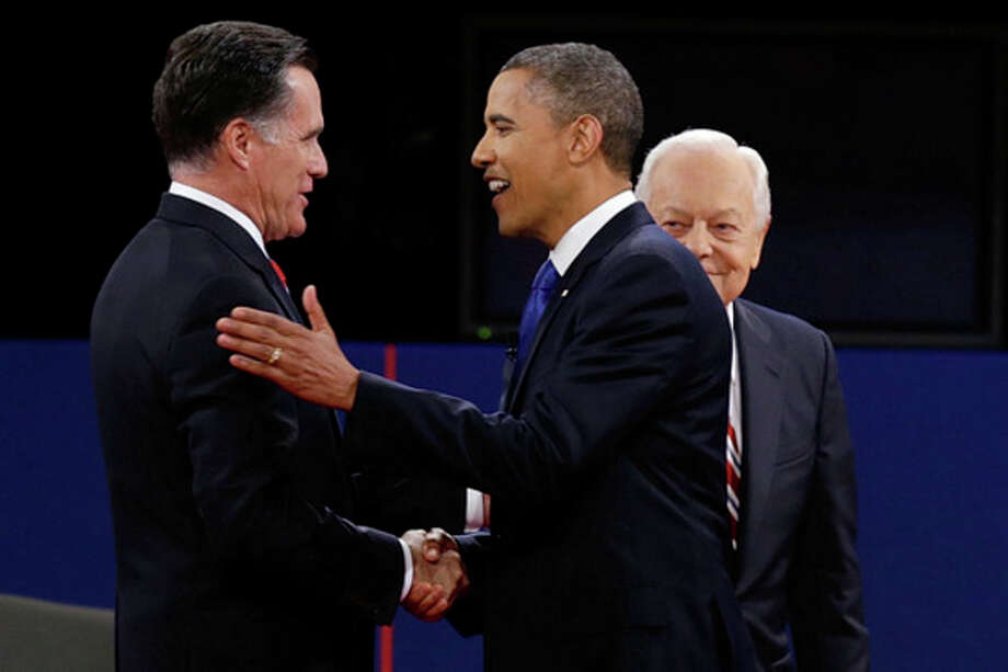 Republican presidential nominee Mitt Romney and President Barack Obama shake hands as moderator Bob Schieffer looks on during the third presidential debate at Lynn University, Monday, Oct. 22, 2012, in Boca Raton, Fla. (AP Photo/Charlie Neibergall) / AP