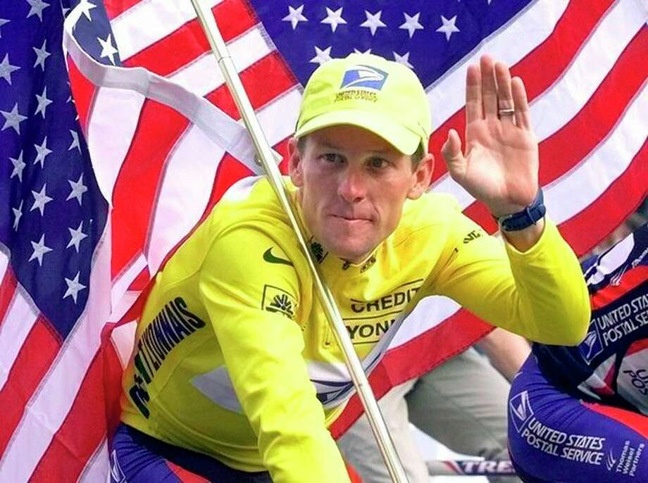FILE - This July 23, 2000 file photo shows Tour de France winner Lance Armstrong riding down the Champs Elysees with an American flag after the 21st and final stage of the cycling race in Paris, France, Armstrong was stripped of his seven Tour de France titles and banned for life by cycling's governing body Monday, Oct. 22, 2012, following a report from the U.S. Anti-Doping Agency that accused him of leading a massive doping program on his teams. UCI President Pat McQuaid announced that the federation accepted the USADA's report on Armstrong and would not appeal to the Court of Arbitration for Sport. (AP Photo/Laurent Rebours, File) / AP