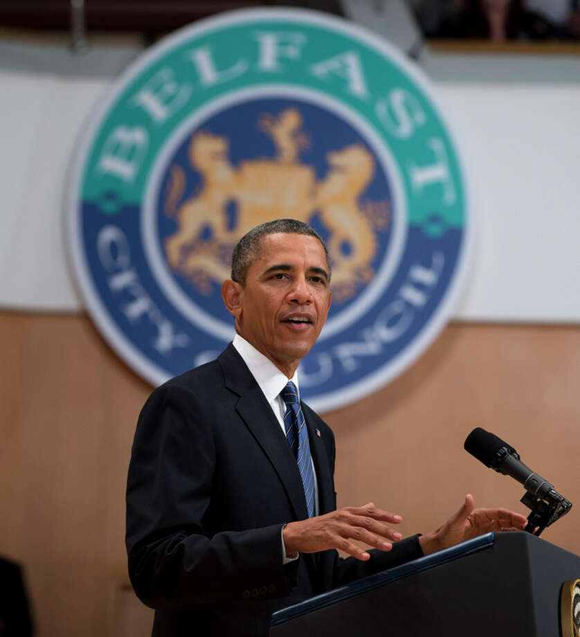 President Barack Obama gestures during a speech at the Belfast Waterfront Hall on Monday June 17, 2013, in Belfast, Northern Ireland. Obama is attending the G-8 summit in Enniskillen, Northern Ireland where leaders are expected to discuss the ongoing conflict in Syria, and free-trade issues. (AP Photo/Evan Vucci) / AP