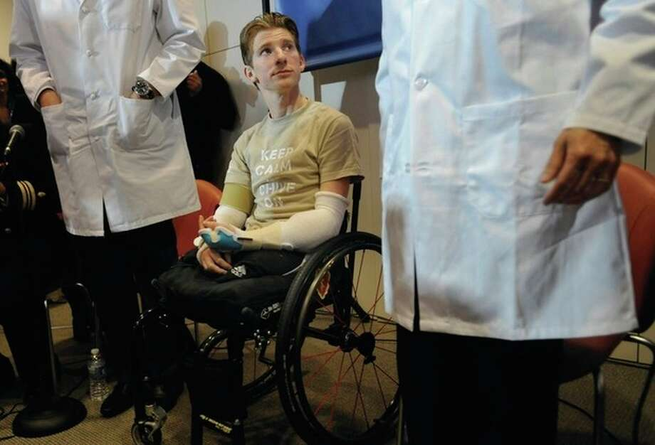 AP file photo / Gail BurtonRetired Infantryman Brendan M. Marroccoreceived a transplant of two arms from a deceased donor after losing all four limbs in a 2009 roadside bomb attack in Iraq. / FR4095 AP