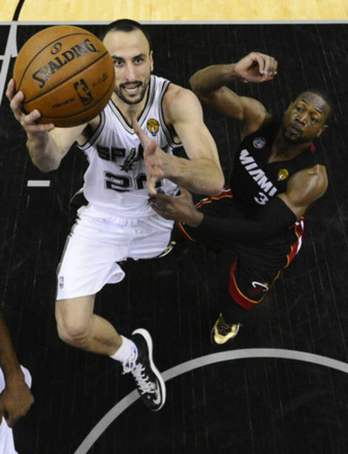 San Antonio Spurs' Manu Ginobili (20), of Argentina, shoots as Miami Heat's Dwyane Wade defends during the second half at Game 5 of the NBA Finals basketball series, Sunday, June 16, 2013, in San Antonio. The Spurs won 114-104. (AP Photo/John G. Mabanglo)