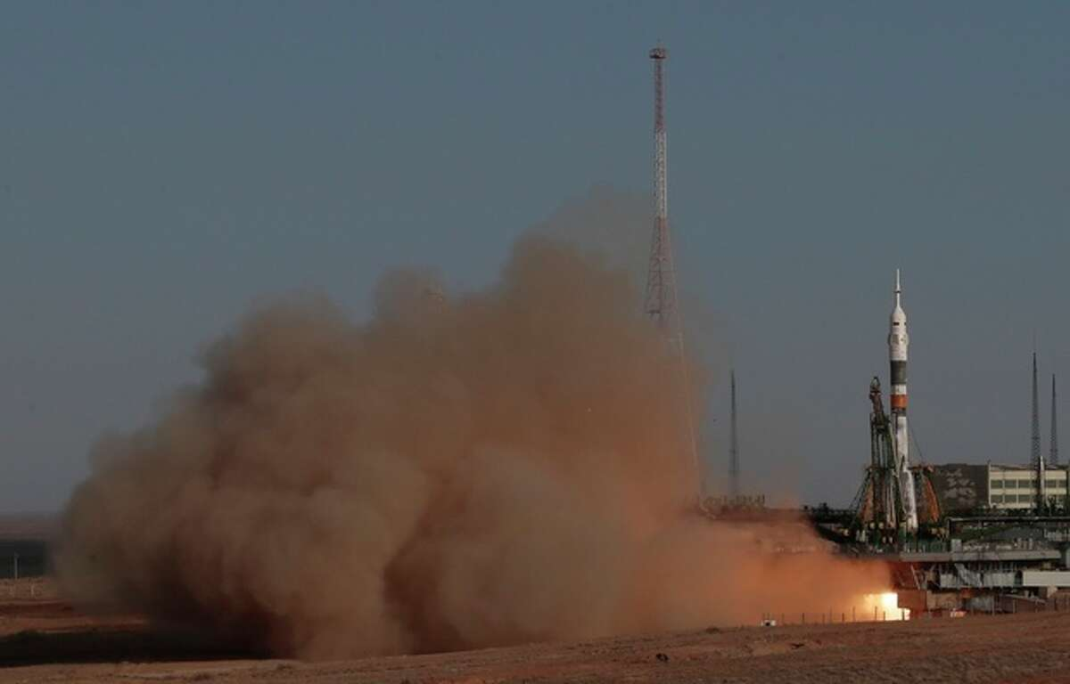 The Soyuz-FG rocket booster with Soyuz TMA-06M space ship carrying a new crew to the International Space Station, ISS, blasts off from the Russian-leased Baikonur cosmodrome, Kazakhstan, Tuesday, Oct. 23, 2012. The Russian rocket carries U.S. astronaut Kevin Ford and two Russian cosmonauts Oleg Novitsky and Evgeny Tarelkin. (AP Photo/Mikhail Metzel)