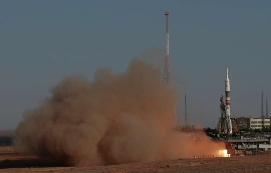 The Soyuz-FG rocket booster with Soyuz TMA-06M space ship carrying a new crew to the International Space Station, ISS, blasts off from the Russian-leased Baikonur cosmodrome, Kazakhstan, Tuesday, Oct. 23, 2012. The Russian rocket carries U.S. astronaut Kevin Ford and two Russian cosmonauts Oleg Novitsky and Evgeny Tarelkin. (AP Photo/Mikhail Metzel) / AP