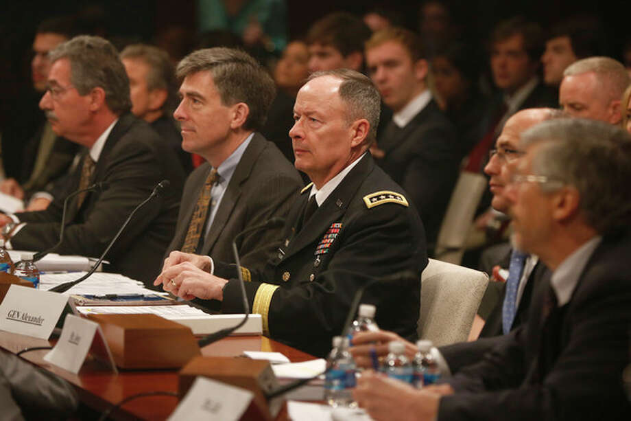 From left, Deputy Attorney General James Cole; National Security Agency (NSA) Deputy Director Chris Inglis; NSA Director Gen. Keith B. Alexander; Deputy FBI Director Sean Joyce; and Robert Litt, general counsel to the Office of the Director of National Intelligence; prepares to testify on Capitol Hill in Washington, Tuesday, June 18, 2013, before the House Intelligence Committee hearing regarding NSA surveillance. (AP Photo/Charles Dharapak) / AP