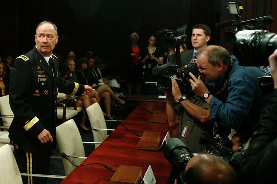 National Security Agency (NSA) Director Gen. Keith B. Alexander approaches the witness table on Capitol Hill in Washington, Tuesday, June 18, 2013, to testify before the House Intelligence Committee hearing regarding NSA surveillance. (AP Photo/Charles Dharapak) / AP