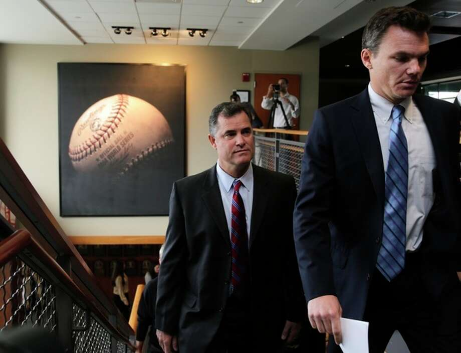 Boston Red Sox manager John Farrell follows general manager Ben Cherrington as they arrive for a news conference at Fenway Park in Boston, Tuesday, Oct. 23, 2012. Farrell becomes the 46th manager in the club's 112-year history. (AP Photo/Charles Krupa) / AP