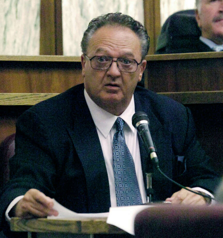 """FILE - In this Sept. 17, 2008 file photo, John Martorano is questioned about his plea agreement in exchange for testifying against former FBI agent John Connolly, in the Miami Courthouse. Connolly is accused of helping the Boston mob murder Miami gambling executive John Callahan in 1982, at Miami International Airport. Martorano, who served 12 years in prison after a plea deal, and who has admitted killing 20 people, is expected to testify at the trial of James """"Whitey"""" Bulger, Monday, June 17, 2013 in federal court in Boston. (AP Photo/Marice Cohn Band, Pool, File) / Pool The Miami Herald"""
