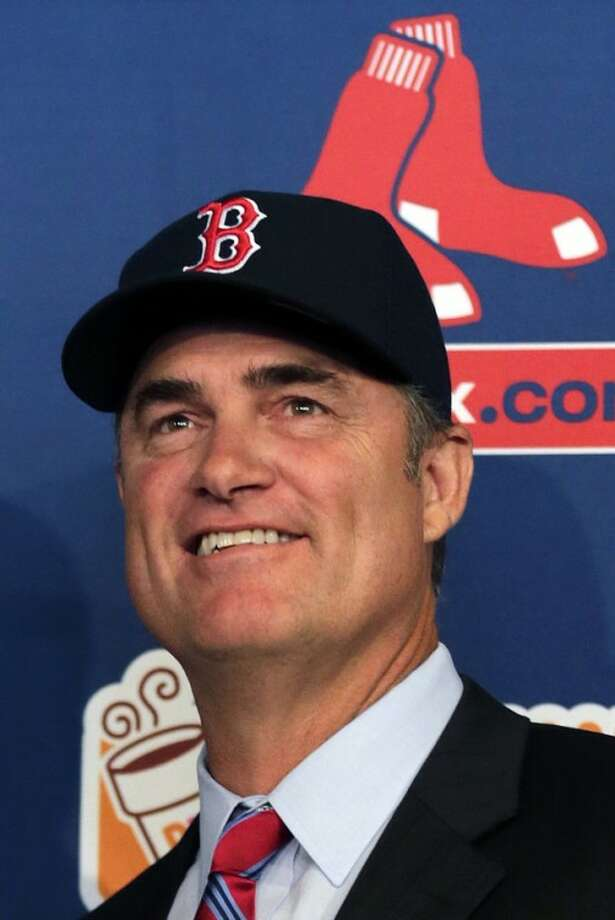New Boston Red Sox manager John Farrell smiles during a news conference at Fenway Park in Boston, Tuesday, Oct. 23, 2012. Farrell becomes the 46th manager in the clubs 112-year history. (AP Photo/Charles Krupa)