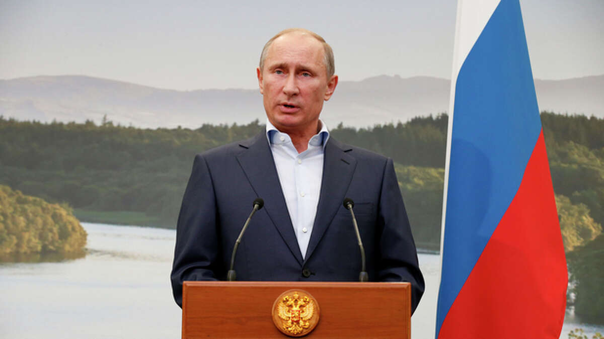 Russian President Vladimir Putin speaks during a media conference after a G-8 summit at the Lough Erne golf resort in Enniskillen, Northern Ireland, on Tuesday, June 18, 2013. The final day of the G-8 summit of wealthy nations is ending with discussions on globe-trotting corporate tax dodgers, a lunch with leaders from Africa, and suspense over whether Russia and Western leaders can avoid diplomatic fireworks over their deadlock on Syria?'s civil war. (AP Photo/Matt Dunham, Pool)