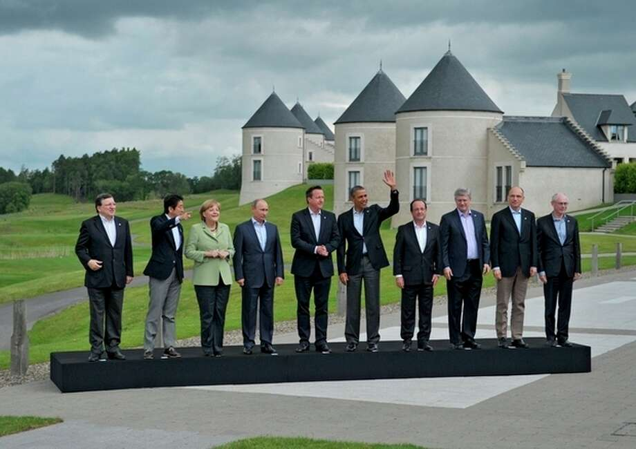 G-8 leaders from left, European Commission President Jose Manuel Barroso, Japan's Prime Minister Shinzo Abe, German Chancellor Angela Merkel, British Prime Minister David Cameron, US President Barack Obama, Russian President Vladimir Putin, French President Francois Hollande, Canadian Prime Minister Stephen Harper, Italian Prime Minister Enrico Letta and European Council President Herman Van Rompuy walk to a group photo opportunity during the G-8 summit at the Lough Erne golf resort in Enniskillen, Northern Ireland, on Tuesday, June 18, 2013. The final day of the G-8 summit of wealthy nations is ending with discussions on globe-trotting corporate tax dodgers, a lunch with leaders from Africa, and suspense over whether Russia and Western leaders can avoid diplomatic fireworks over their deadlock on Syria?s civil war. (AP Photo/RIA-Novosti, Alexei Nikolsky, Presidential Press Service) / RIA Novosti Presidential Press Service