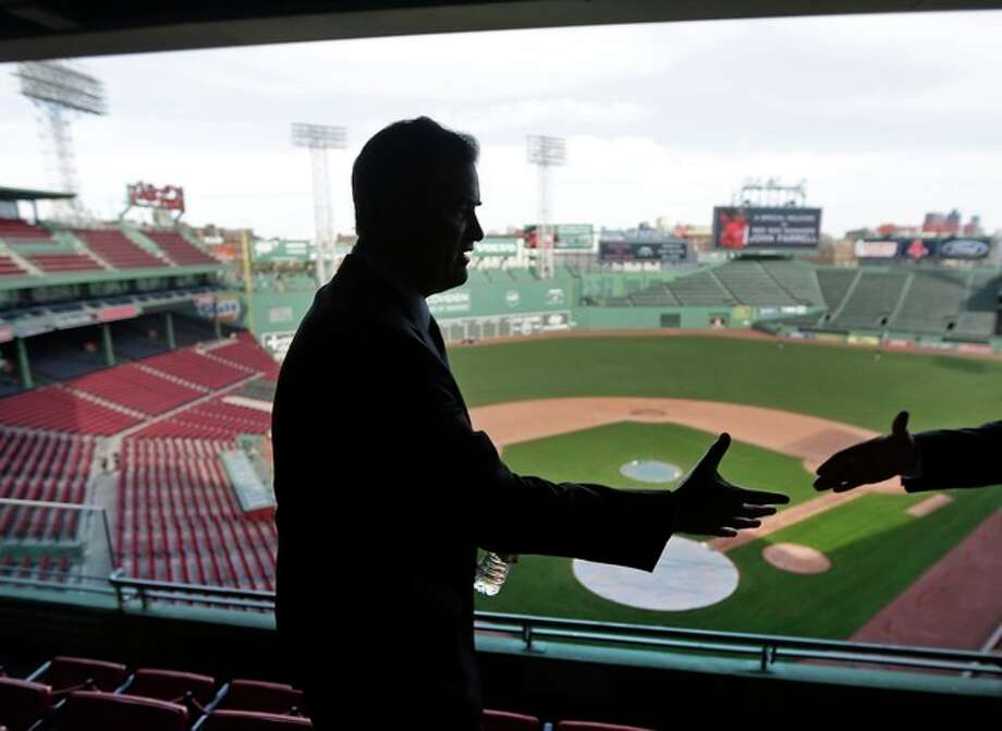 Boston Red Sox manager John Farrell reaches out to shake hands at Fenway Park in Boston, Tuesday, Oct. 23, 2012. Farrell becomes the 46th manager in the club's 112-year history. (AP Photo/Charles Krupa) / AP