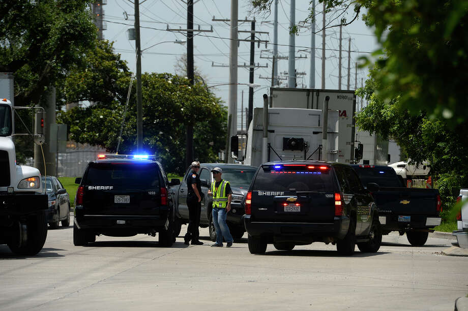 Deputies with the Jefferson County Sheriff's Office block the road heading into the ExxonMobil refinery in Beaumont after a bomb threat on Wednesday.  Photo taken Wednesday 6/15/16 Ryan Pelham/The Enterprise Photo: Ryan Pelham / ©2016 The Beaumont Enterprise/Ryan Pelham
