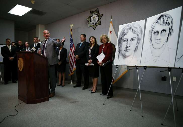 Sgt. Paul Belli of the Sacramento County Sheriff's Department gestures toward sketches while speaking to the media at a news conference at the sheriff's department in Sacramento, California, on Wednesday, June 15, 2016. Law enforcement agencies announced a national campaign to identify and apprehend the East Area Rapist, also known as the Golden State Killer, who committed his first crime 40 years ago.