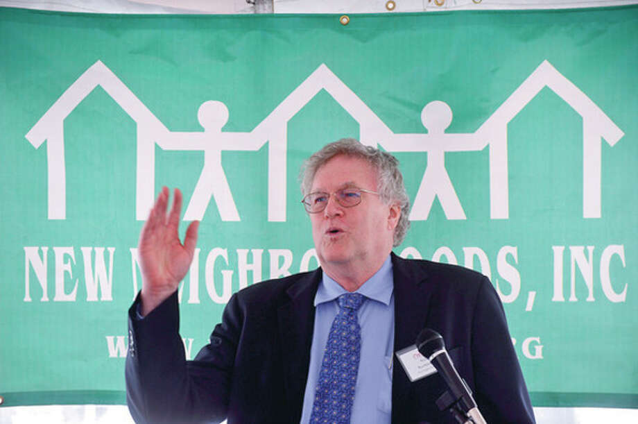 President and CEO of New Neighborhood's Inc., Ross Burkhardt, speaks at the New Neighborhood's Marshall Commons grand opening in Stamford Tuesday. New Neighborhood's provide affordable, energy-efficient housing to low- and moderate-income families.Hour photo / Erik Trautmann / (C)2012, The Hour Newspapers, all rights reserved