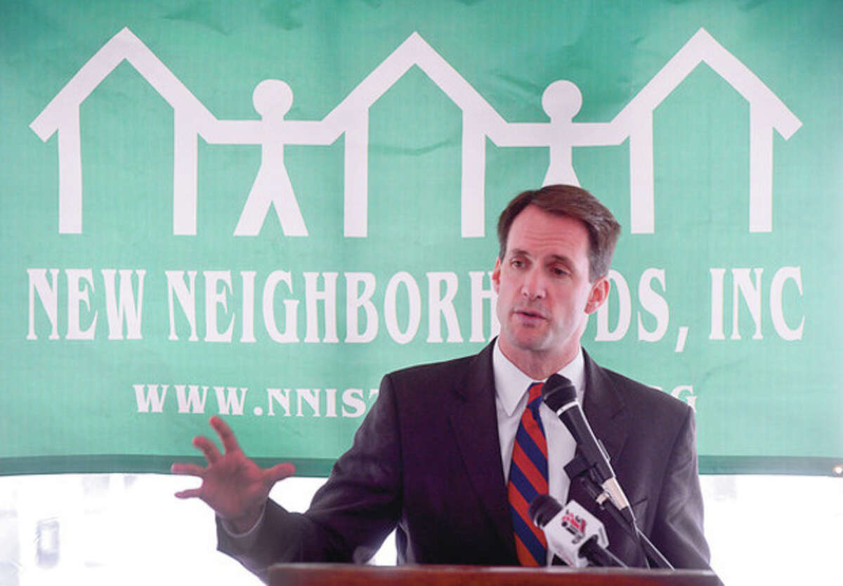 Photo by Erik Trautmann U.S. Rep. Jim Himes speaks at the New Neighborhood's Marshall Commons grand opening in Stamford.