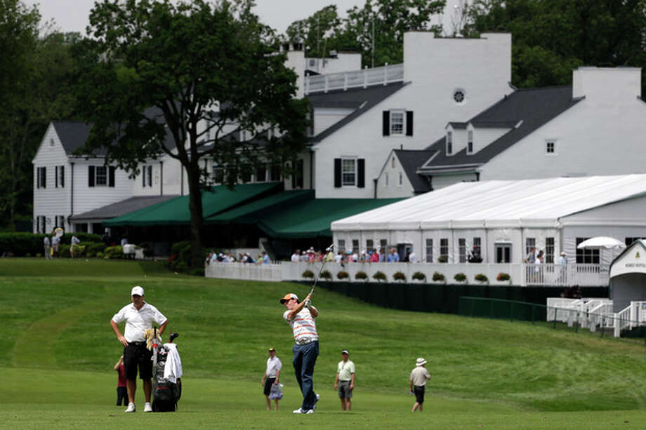 Rory McIlroy, of Northern Ireland, hits down the first fairway during practice for the U.S. Open golf tournament at Merion Golf Club, Tuesday, June 11, 2013, in Ardmore, Pa. (AP Photo/Darron Cummings) / AP