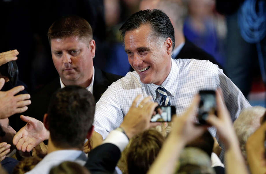 Republican presidential candidate and former Massachusetts Gov. Mitt Romney greets supporters during a campaign stop, Wednesday, Oct. 24, 2012, at the Eastern Iowa Airport in Cedar Rapids, Iowa. (AP Photo/Charlie Neibergall) / AP
