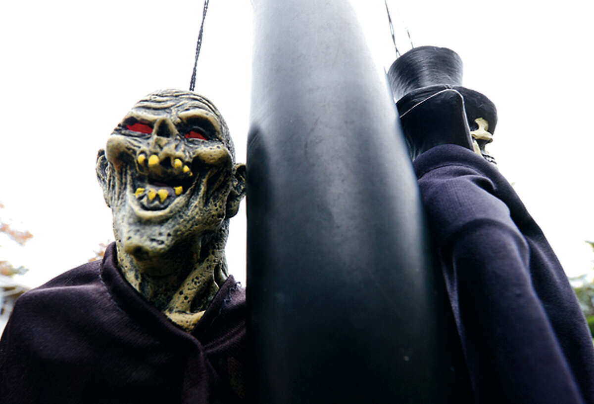 Local residents decorate their homes for Halloween. Hour photo / Erik Trautmann