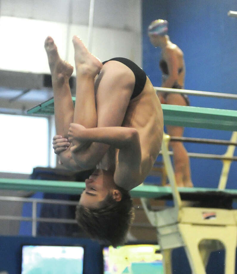 Hour photo/John NashKevin Bradley of Norwalk performs one of his dives during a practice at the New Canaan YMCA Thursday. Bradley will compete in the 12-13-year-old division during this weekend's Summer Junior Region I championship diving meet this weekend in New Canaan.