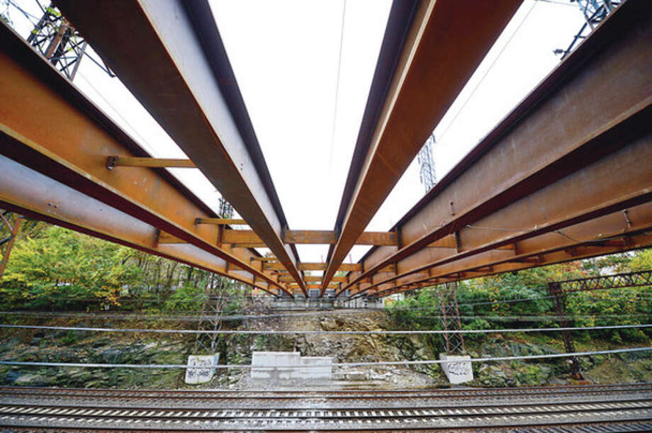 Reconstruction of the Triangle Street Bridge is running at least a month behind schedule. State Department of Transportation cites engineering problems related to Metro-North Railroad catenary lines.Hour photo / Erik Trautmann / (C)2012, The Hour Newspapers, all rights reserved