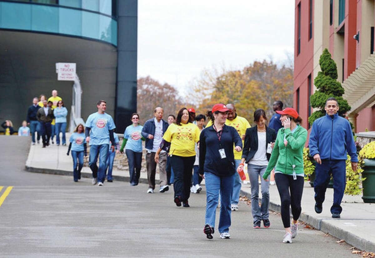 Nearly a hundred Diageo employees walked to raise money for the American Diabetes Association. Hour photo / Erik Trautmann